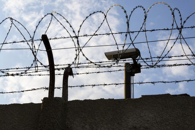 barbed wire fence prison. Download Security Camera Behind Barbed Wire Fence Around Prison Walls Stock Image - Of Cctv