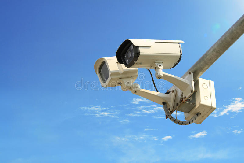Security camera. On blue sky background royalty free stock photo