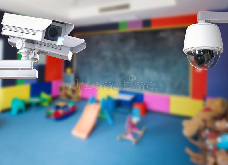 Security camera or cctv camera. 3d rendering cctv camera or security camera on kids room background stock photo