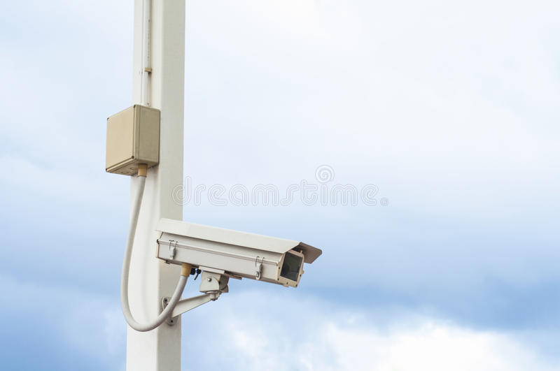 Security Camera on cloudy sky royalty free stock photo