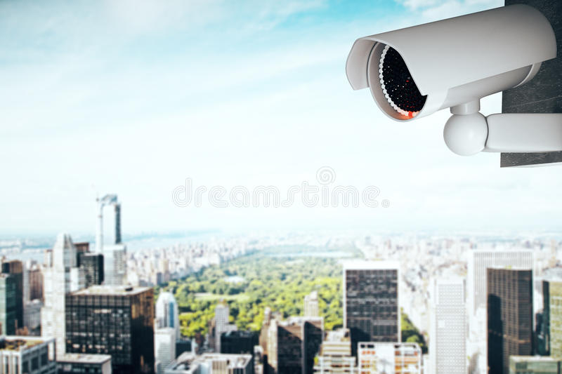 Security camera on contemporary city background. 3D Rendering of a white CCTV security camera on contemporary city background with copy space vector illustration