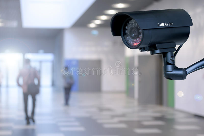 Security camera in the corporation. The concept of security through surveillance camera in the corporation or government building stock images