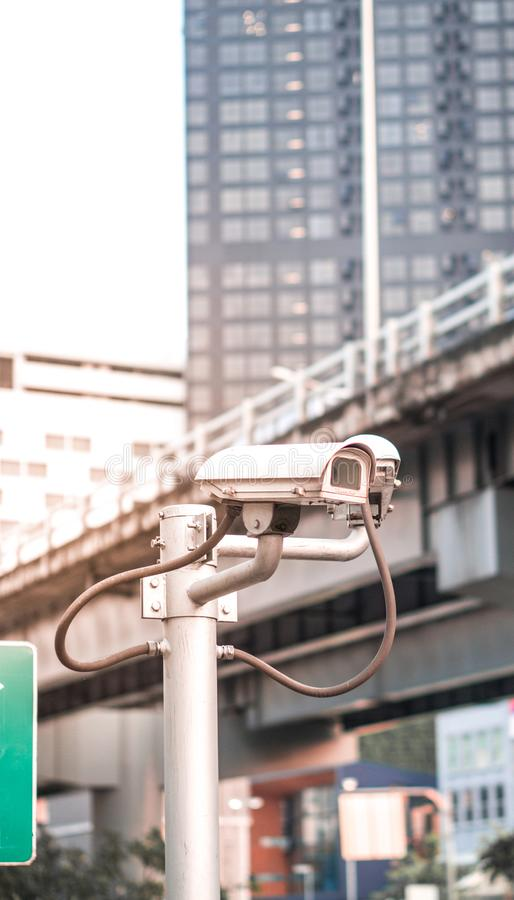Security camera equipment on pole in evening traffic light with flare light effect and copyspace. Security camera equipment and traffic concept - Security camera royalty free stock images