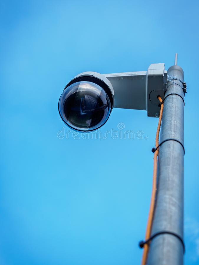 Security camera on pole stock images