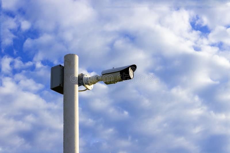Security camera on the pole stock photography
