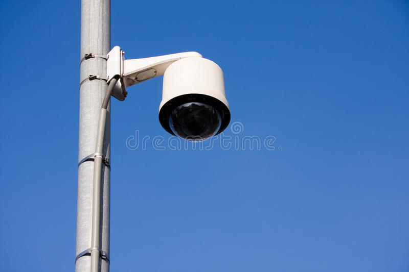 Security camera on post stock images