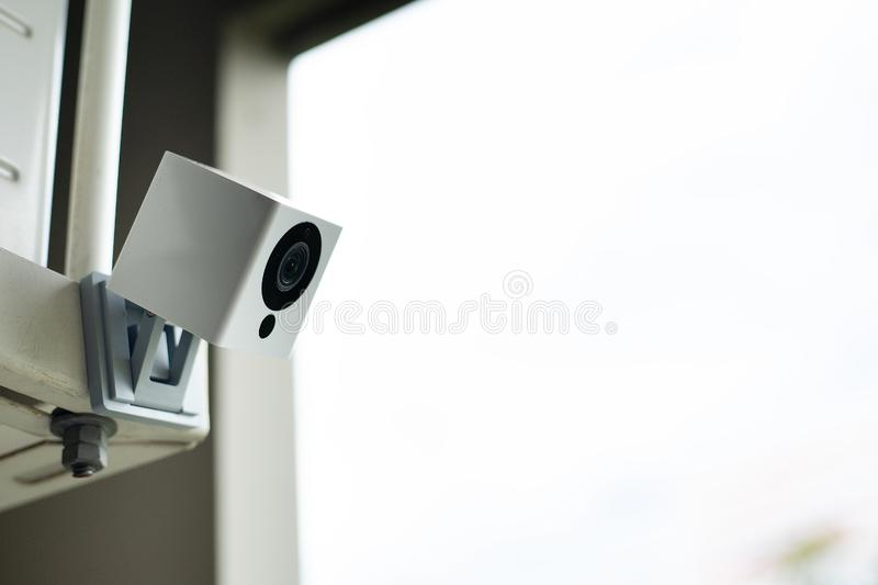 Security Camera watching the garden stock photography