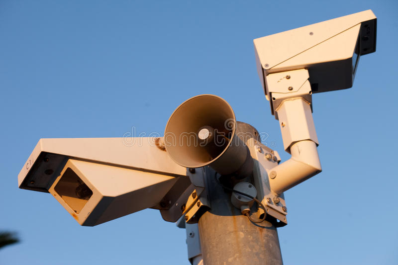 Security cameras. And warning loudspeaker in afternoon stock images