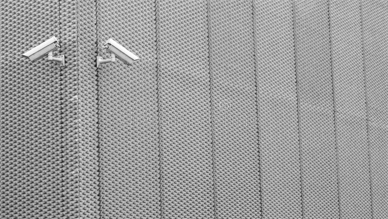 Security cameras on aluminum fence royalty free stock photography