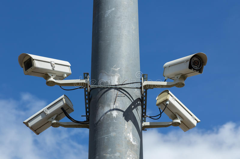 Security cameras with blue sky. Security cameras with pole under blue sky royalty free stock photos