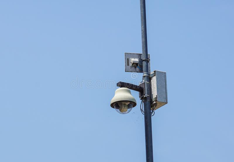 Security cameras in front of blue sky - with space for text.  royalty free stock image
