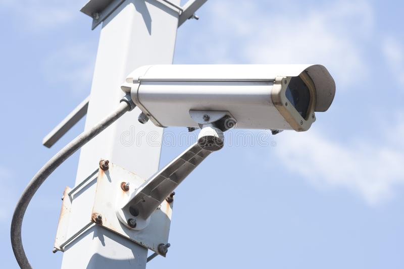 Security cameras in garden. On blue sky background royalty free stock image