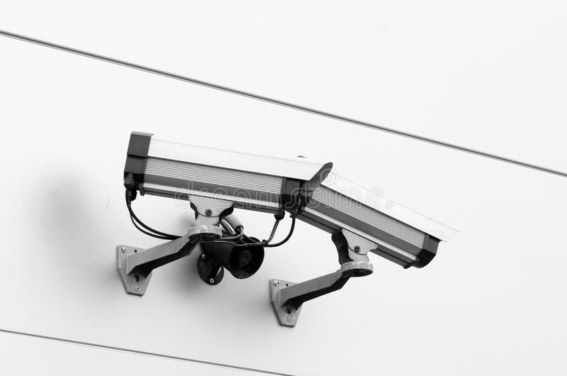 Surveillance Security cameras. Security cameras mounted on a wall royalty free stock photo