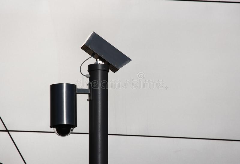 Security cameras silhouette stock images