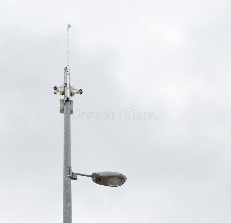 Security cameras and street light stock photos