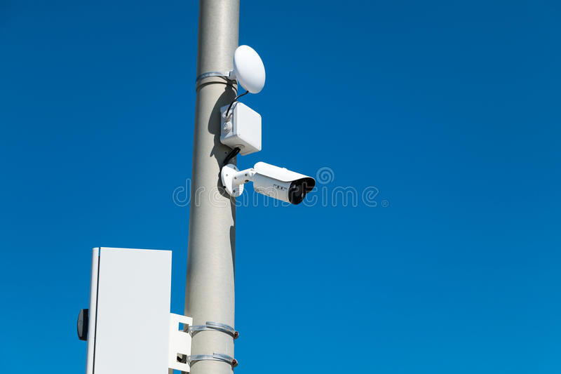Security cameras on street pylon. With blue sky stock photos