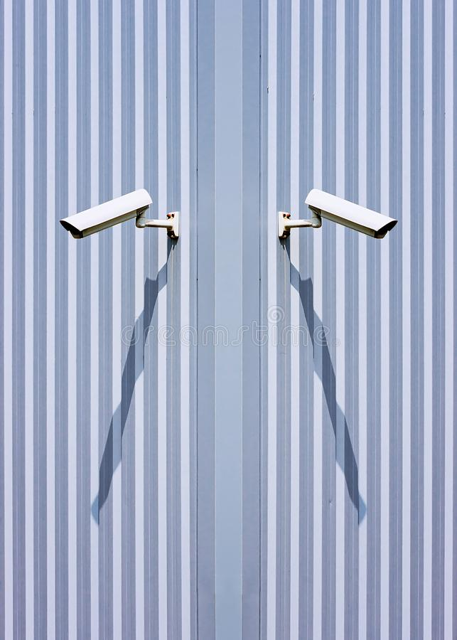 Security cameras on wall. Surveillance security cameras on wall stock photo