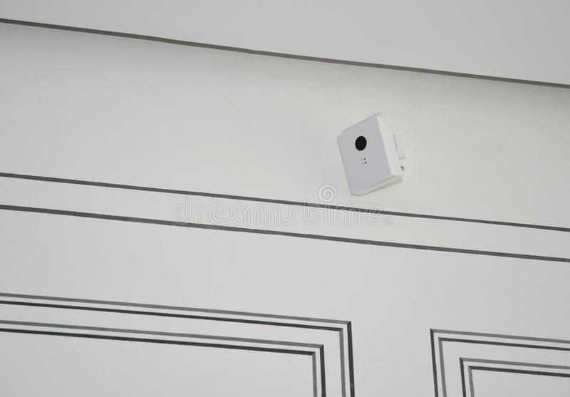 Security CCTV camera is mounted on the room wall. Security CCTV camera is mounted on the flat room wall royalty free stock photography