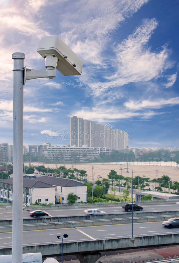 Security CCTV camera on road in city royalty free stock images