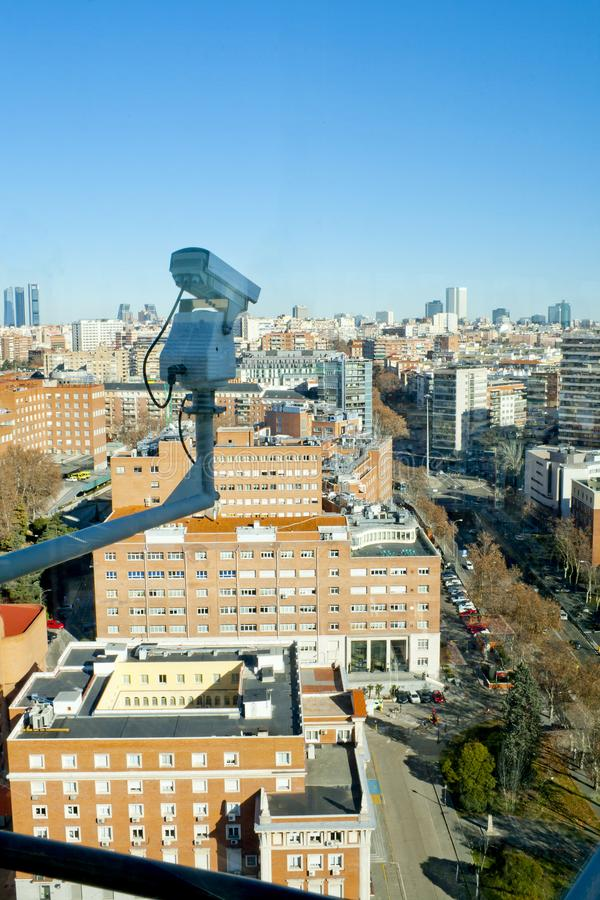 Security CCTV camera or surveillance system in a city stock images