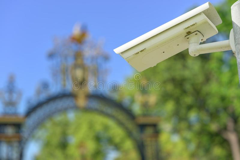 Security CCTV camera or surveillance system with entry portal on blurry background. Focus on security CCTV camera or surveillance system with entry portal on royalty free stock photo