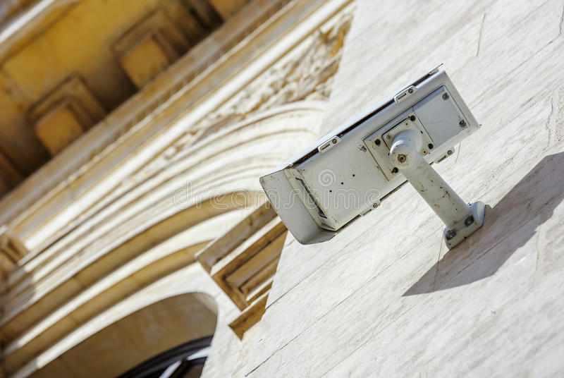 Security CCTV camera or surveillance system fixed on old construction wall royalty free stock photo