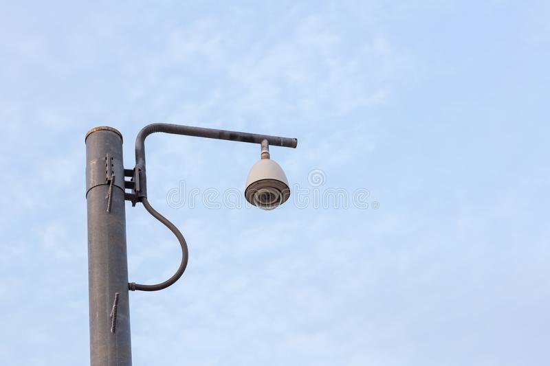 Security CCTV camera surveillance system outdoor of house. A blurred night city scape background. Modern CCTV camera on a wall. royalty free stock image