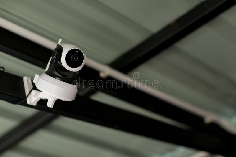 Security CCTV camera surveillance system outdoor of house. A blurred night city scape background. Modern CCTV camera on a wall. stock images