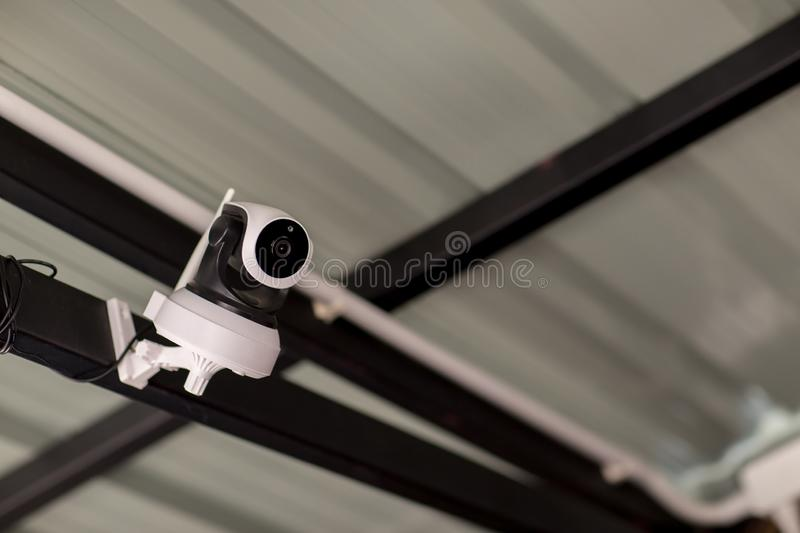 Security CCTV camera surveillance system outdoor of house. A blurred night city scape background. Modern CCTV camera on a wall. stock image