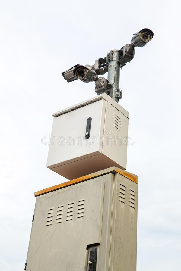 Security CCTV camera surveillance system outdoor of house. A blurred night city scape background. Modern CCTV camera on a wall. Equipment system service for royalty free stock photo