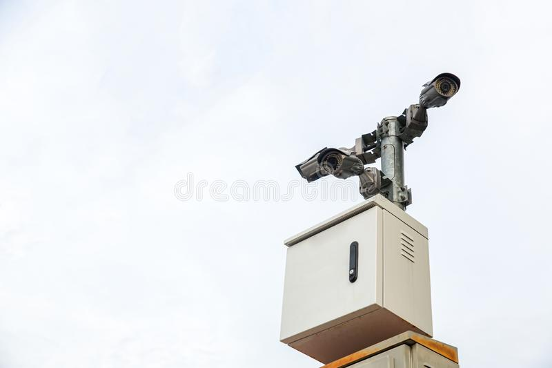 Security CCTV camera surveillance system outdoor of house. A blurred night city scape background. Modern CCTV camera on a wall. Equipment system service for stock image