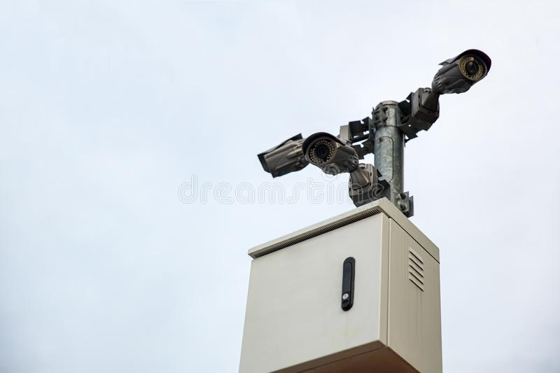 Security CCTV camera surveillance system outdoor of house. A blurred night city scape background. Modern CCTV camera on a wall. Equipment system service for royalty free stock photos