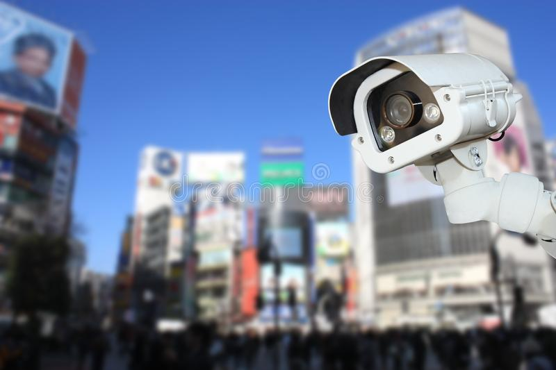Security CCTV camera or surveillance system with traveler tokyo. On blurry background royalty free stock images