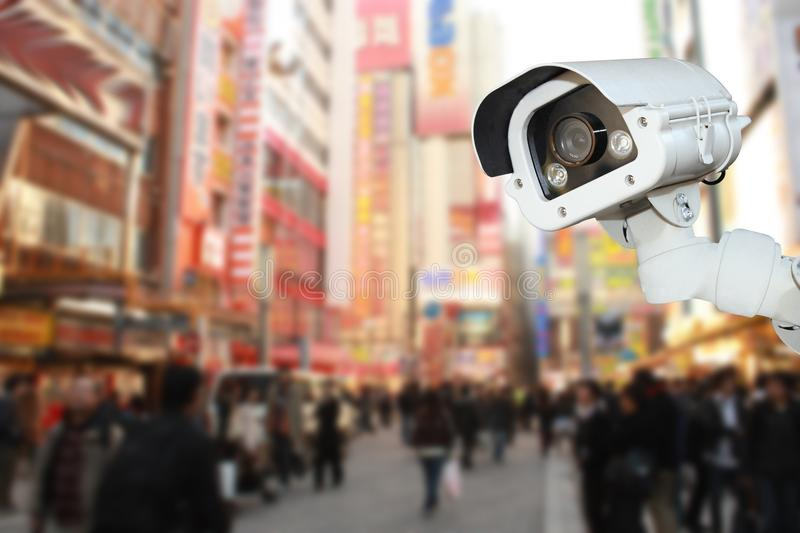 Security CCTV camera or surveillance system with traveler tokyo. On blurry background stock photo