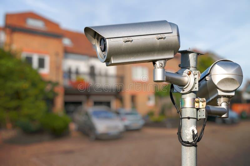 Security CCTV video camera monitoring home. royalty free stock photos