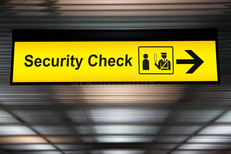 Security check sign hanging from airport terminal ceiling royalty free stock photo