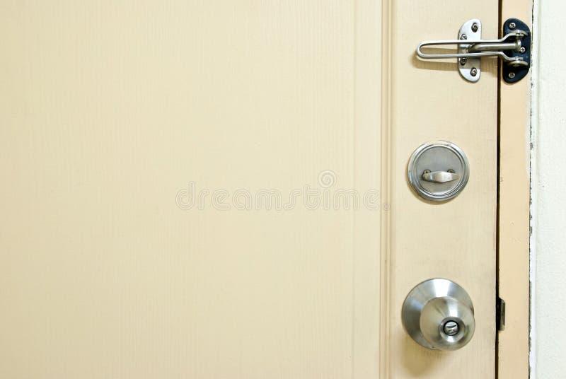 Security door. Close up locked wooden door for security royalty free stock photos