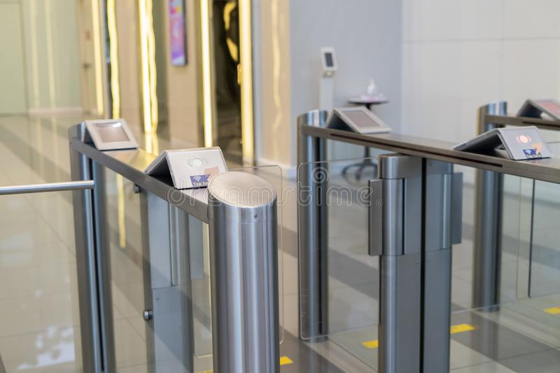 Security at an entrance gate with key card access control smart office building stock photos
