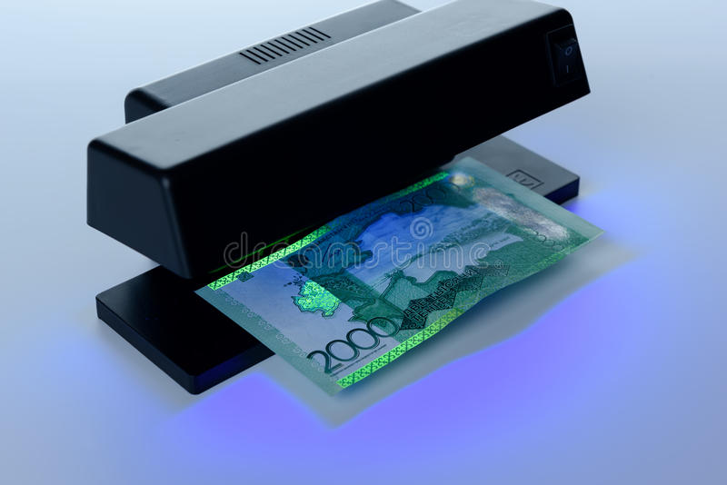 Security features on banknote in UV light protection royalty free stock photos