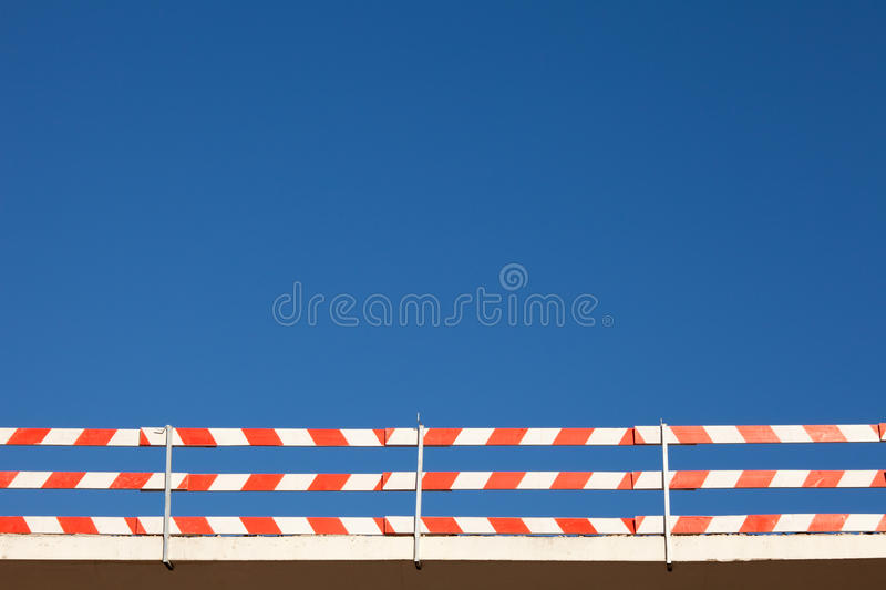 Security fence. Security construction fence with the sky as background stock photography
