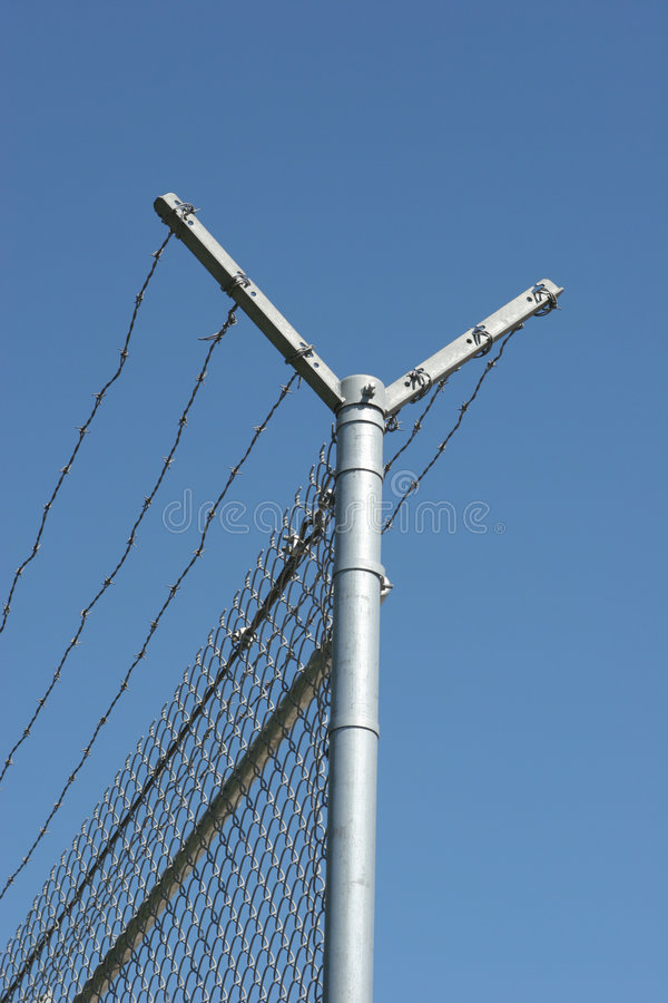 Security fence. And barbed wire royalty free stock photo
