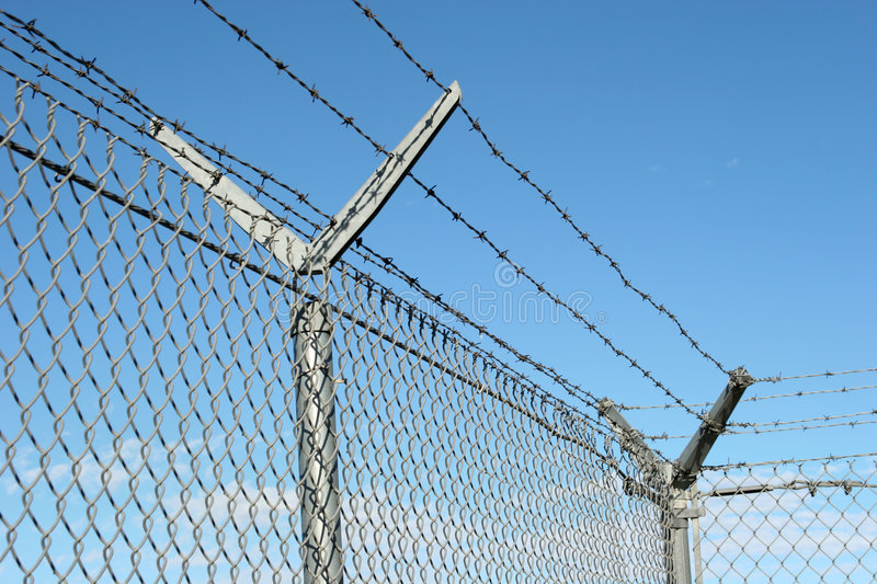 Security fence. And barbed wire royalty free stock photography