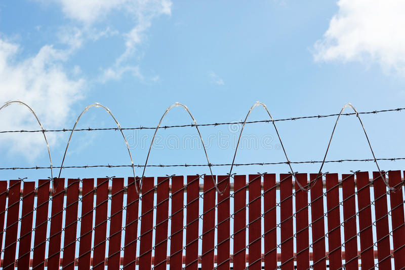 Security Fence. Photo of a section of barbed wire security fence royalty free stock image