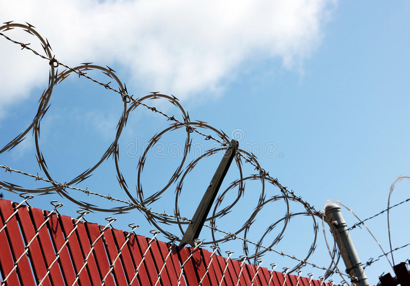 Security Fence. Photo of a sectio of barbed wire security fence royalty free stock image