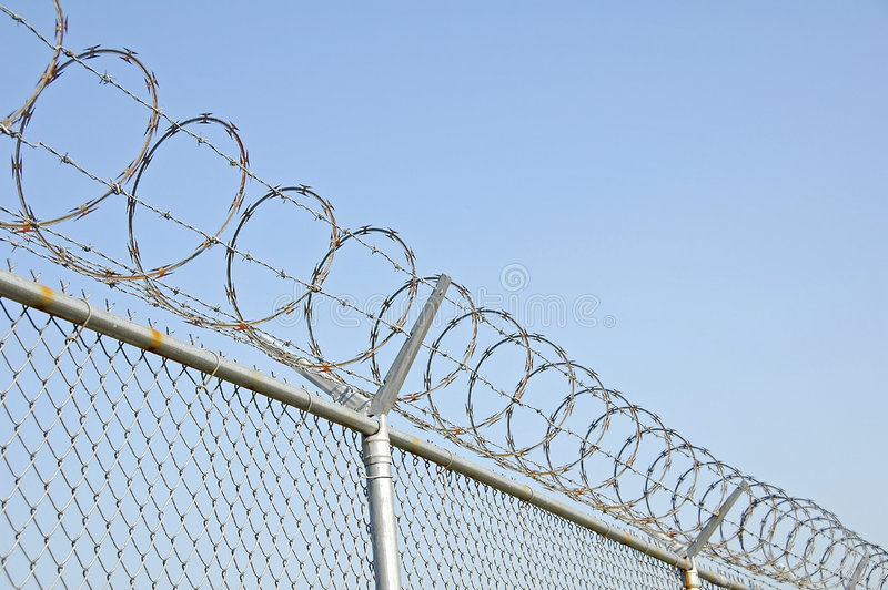 Security Fence 2. Security fence with razor wire stock image