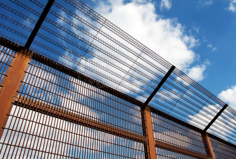 Security fence against blue sky. Security fence against the blue sky stock images