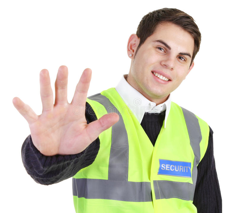 Security guard. A security guard holding his hand out royalty free stock photography