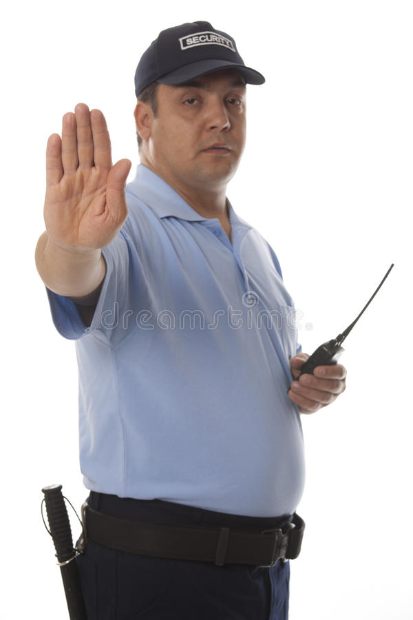 Security guard. A security guard holding his hand out royalty free stock image