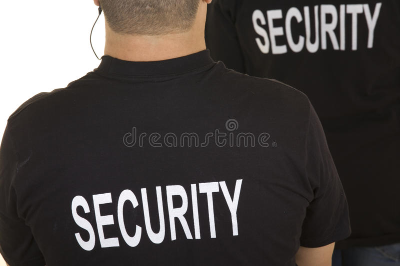 Security guard. Back of two security guards isolated on white stock photo