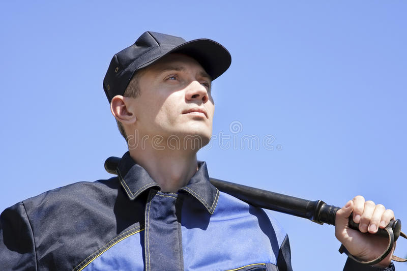 Download The Security Guard With A Bludgeon Stock Photo - Image: 14717876